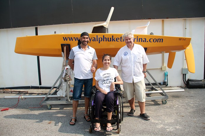 Nawin, Nina and Peter Jacobs pose next to the new boat design.