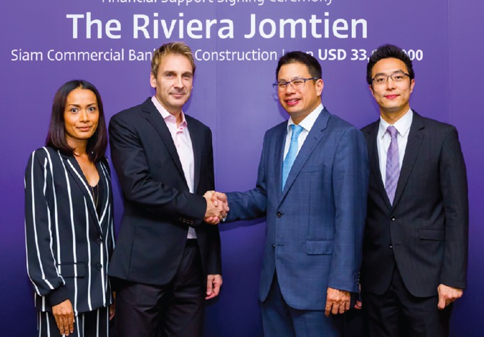 The Billion Baht handshake: (l-r) Sukanya and Winston Gale, owners of The Riviera Group, with Siam Commercial Bank's Executive Vice President Thanawatn Kittisuwan and Executive Vice President Multi-Corporate Parnu Chotiprasidhi.
