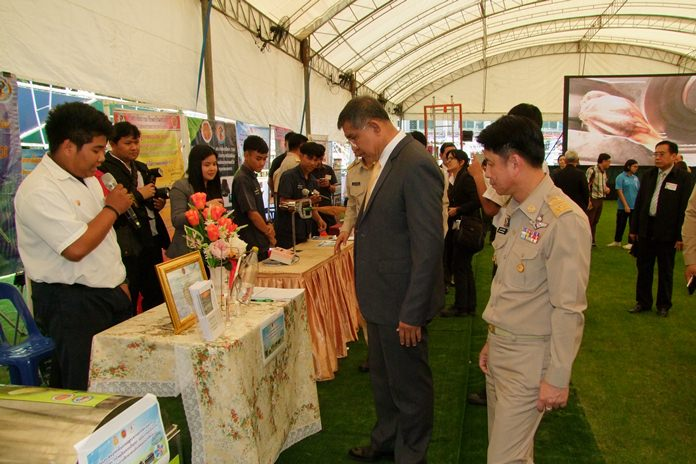 "Deputy Education Minister Surachet Chaiyawong and Chonburi Gov. Pakarathorn Thienchai tour the ""vocational innovation fair"" at Sattahip Technical College."
