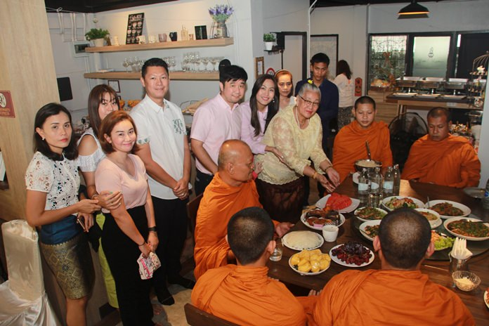 Owner Phisut Saekhu, family members and friends take part in a merit-making ceremony to get Yes Vegan off to a fortuitous start.
