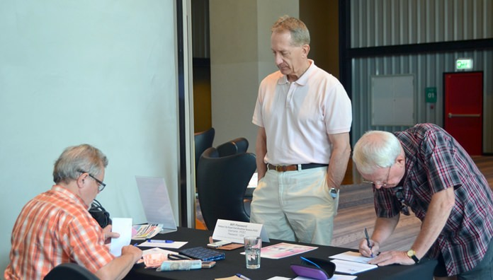 Member Bob Smith mans the membership table at the PCEC meeting; providing information about the PCEC and accepting membership applications before the main program begins.