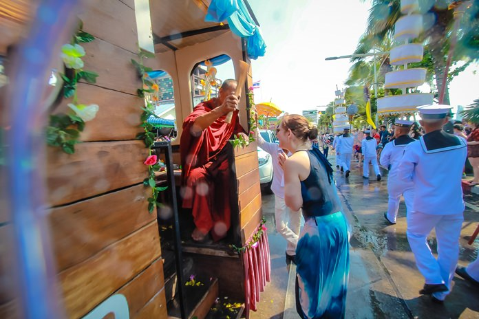 Some of our guests from foreign lands receive blessings from monks aboard the relics parade.