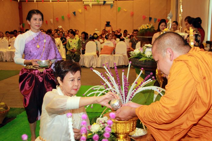 Sopin Thappajug, MD of the Diana Group joins the 'Srong Nam Pra' or lustral water pouring to celebrate Songkran.