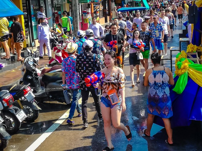 Everyone becomes a water assassin on Beach Road during Songkran.