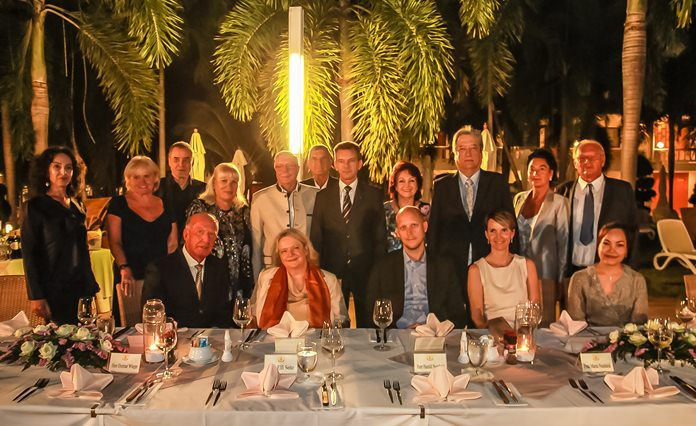 The entourage settles in for a group photo at the end of the Thai Garden Resort welcome dinner.