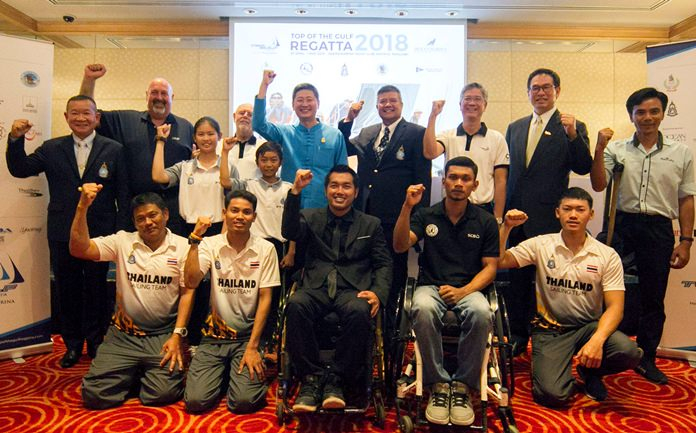 Top of the Gulf Regatta Organising Committee members and tourism officials pose with sailors from the Thai national team and Disabled Sailing Thailand at an April 2 press conference in Bangkok to announce the 2018 Top of the Gulf Regatta.