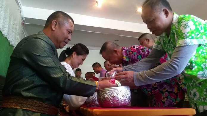 Police Chief Apichai Kroppech and his wife hosted the water-pouring ceremony.