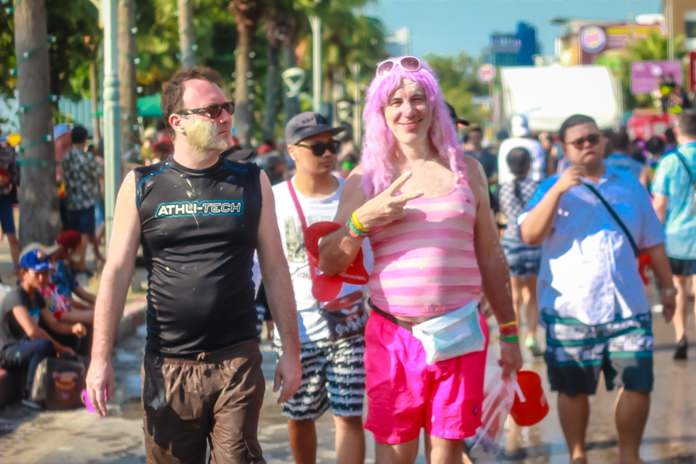 What else but a tourist wearing a pink wig.