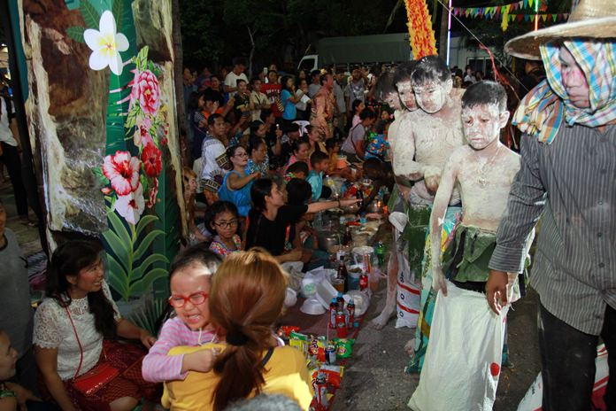 The initial rice piling takes place at Lan Pho Park, where food is prepared for the spirits.