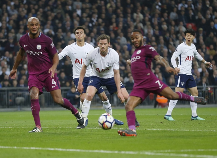 Tottenham Hotspur players look on as Manchester City's Raheem Sterling scores during the English Premier League soccer match between Tottenham Hotspur and Manchester City at Wembley stadium in London, England, Saturday, April 14. (AP Photo/Frank Augstein)