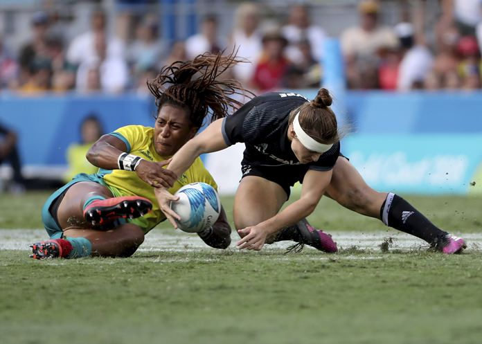New Zealand's Michaela Blyde, right, and Australia's Ellia Green battle for the ball during their women's rugby sevens gold medal match at Robina Stadium during the 2018 Commonwealth Games on the Gold Coast, Australia, Sunday, April 15. (AP Photo/Rick Rycroft)