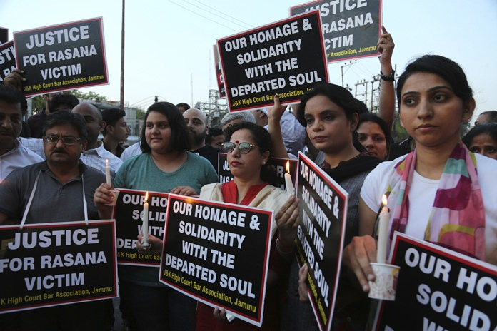 Lawyers participate in a protest against the rape and murder of an 8-year-old girl, in Jammu, India, Saturday, April 14, 2018. The girl was grazing her family's ponies in the forests of the Himalayan foothills when she was kidnapped and her mutilated body found in the woods a week later. (AP Photo/Channi Anand)