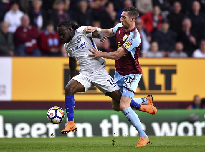 Chelsea's Victor Moses, left, and Burnley's Stephen Ward, challenge for the ball during theit teams' English Premier League match at Turf Moor, in Burnley, Thursday April 19.(Anthony Devlin/PA via AP)