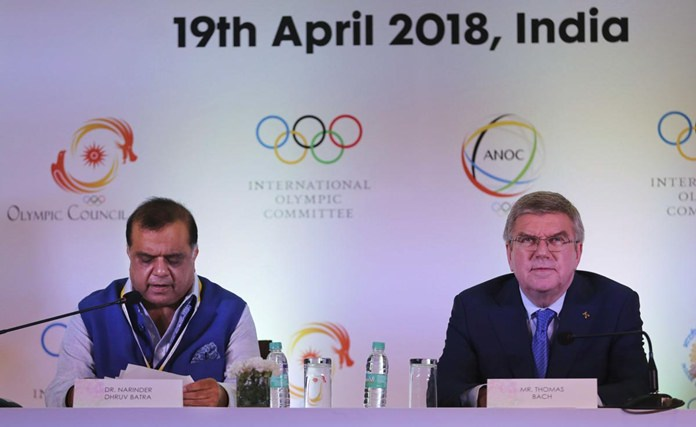 President of the Indian Olympic Association Narinder Dhruv Batra, left, speaks during a press conference with International Olympic Committee (IOC) President Thomas Bach in New Delhi, India, Thursday, April 19. (AP Photo/Altaf Qadri)