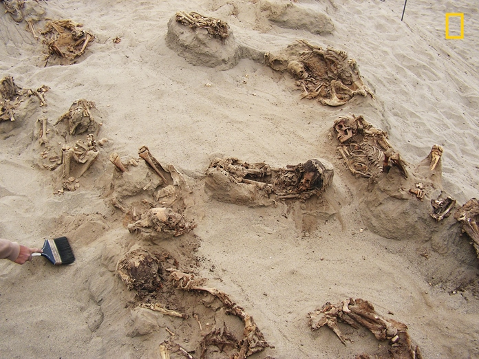 This April 22, 2011 handout photo provided by National Geographic shows more than a dozen bodies preserved in dry sand for more than 500 years, at the Huanchaquito-Las Llamas site near Trujillo, Peru. (Gabriel Prieto/National Geographic via AP)