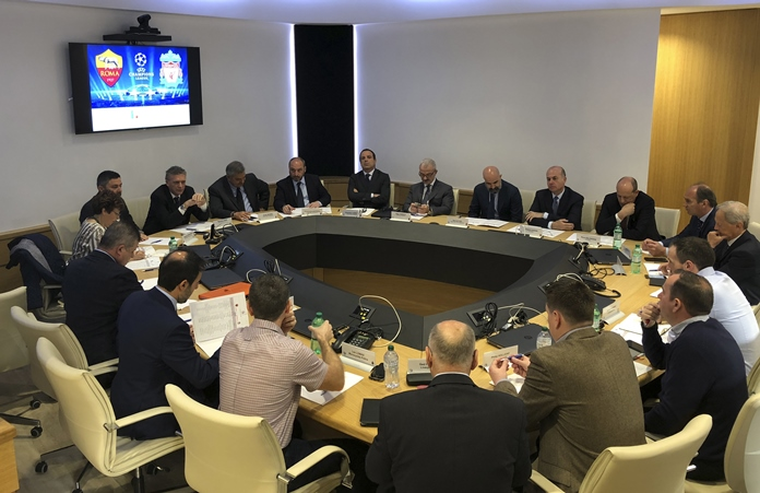 Italian and British authorities attend a security briefing ahead of next Wednesday's Champions League match between Roma and Liverpool, at the Interior Ministry, in Rome, Friday, April 27. (Italian Police via AP)
