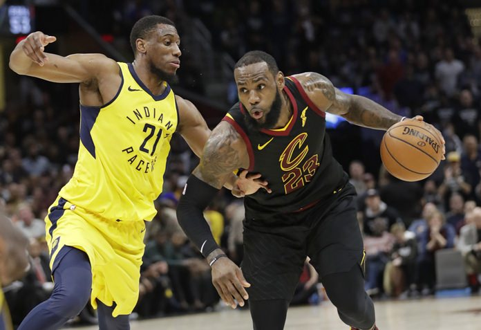 Cleveland Cavaliers' LeBron James (23) drives against Indiana Pacers' Thaddeus Young (21) in the first half of Game 7 of an NBA basketball first-round playoff series, Sunday, April 29, 8, in Cleveland. (AP Photo/Tony Dejak)