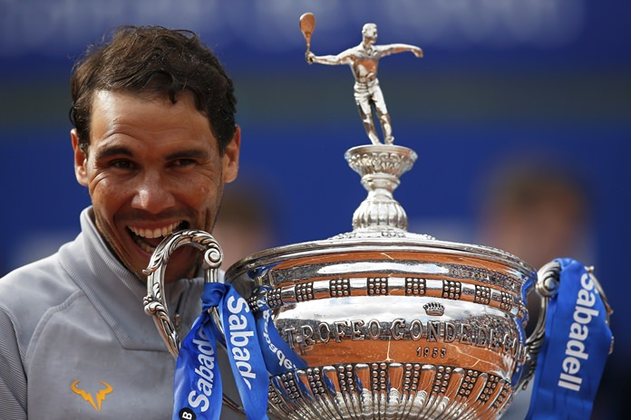 Spain's Rafael Nadal poses with his trophy after winning the Barcelona Open Tennis Tournament final in Barcelona, Spain, Sunday, April 29. (AP Photo/Manu Fernandez)