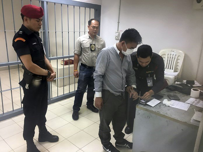 In this Saturday, Jan. 20 file photo, wildlife trafficker Boonchai Bach in processed at a police station in Bangkok. (AP Photo/Tassanee Vejpongsa)