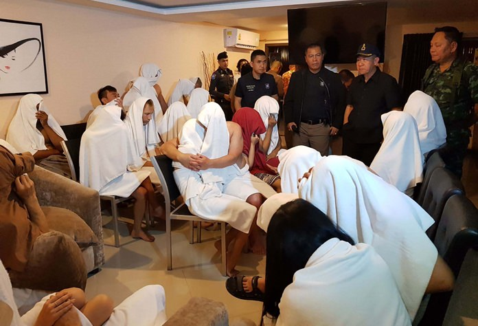 Police arrested 28 naked foreigners and Thais in a raid of sex party at an illegal hotel in Pattaya.