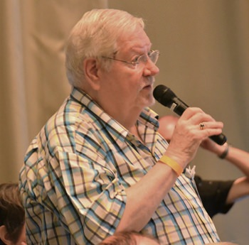 Member Darrel Vaught, one of the organizers for the monthly Club Dinner, announces to PCEC members and guests where and when the next dinner will take place and asks them to put their name on the signup sheet if they plan to attend.