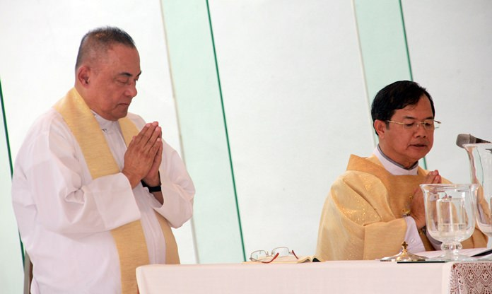 Father Corsie Legaspi (left) and Father Michael celebrate holy mass.