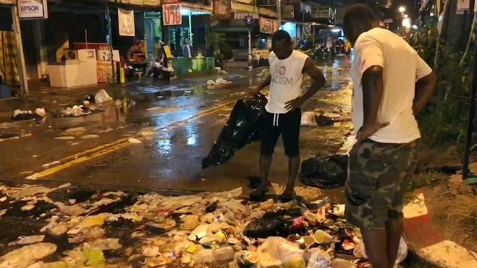Residents and community volunteers look in disgust at the garbage clogging the streets of Pattaya after every rain storm.
