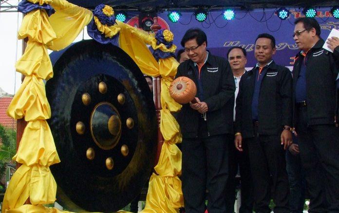 Chonburi Deputy Gov. Chaichan Iamcharoen strikes the huge gong declaring the May Day festivities open.