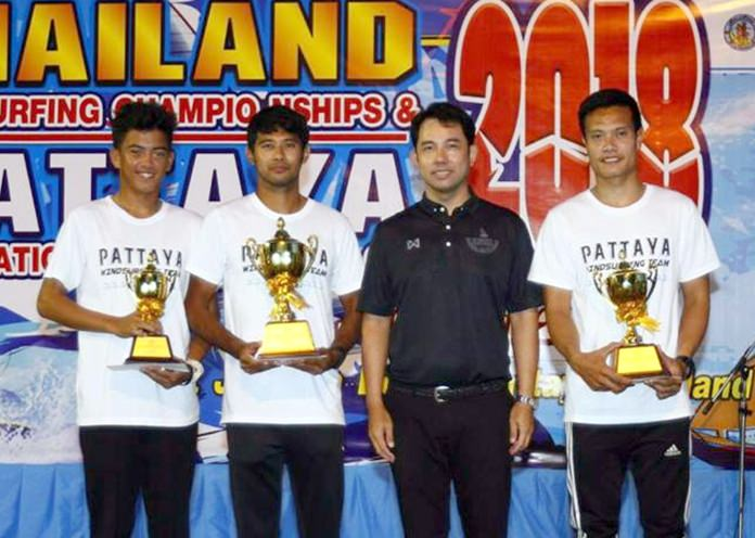 Ittipol Khunplume (2nd right), the assistant Minister of Tourism and Sports and president of the Thailand Windsurfing Association, presents trophies and other prizes to the winners of the Thailand Windsurfing Championships & Pattaya International Windsurfing Cup 2018 during the closing ceremony, April 29.