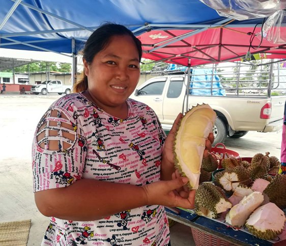 "Fruit vendor Pairin shows off her peeled durian, ""what you see is what you get""."