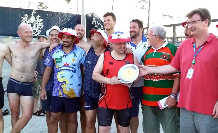 Nigel Westlake, Headmaster of Rugby School (right), presents the Plate to the French Asian Barbarians.