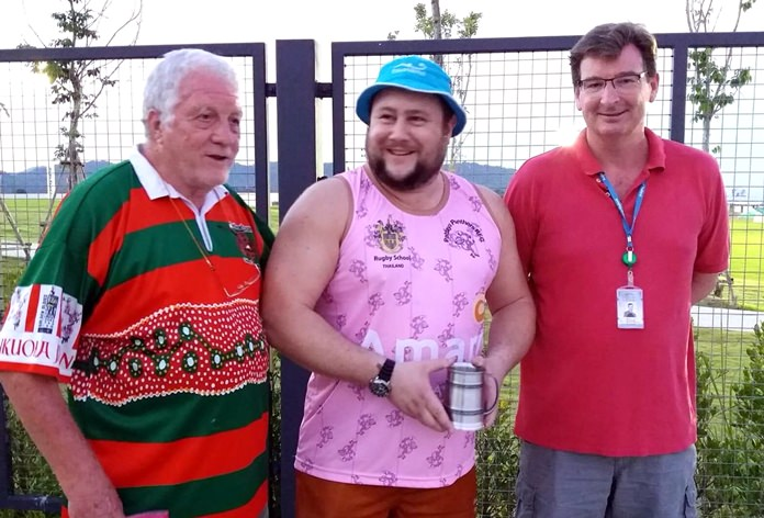 Jim Howard (left) and Nigel Westlake (right) present the Chris Kays Award to Alex Jezard.