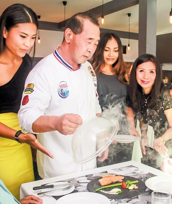 Chef Kato unveils the smoking salmon.
