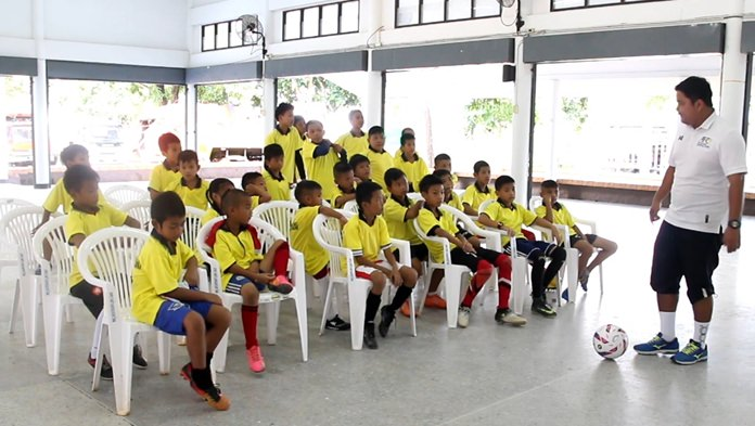 A Pattaya United trainer teaches the kids the basics of football.