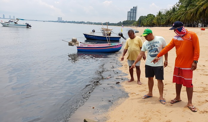 Residents point to the murky waters that mysteriously appeared on Bang Saray beach.