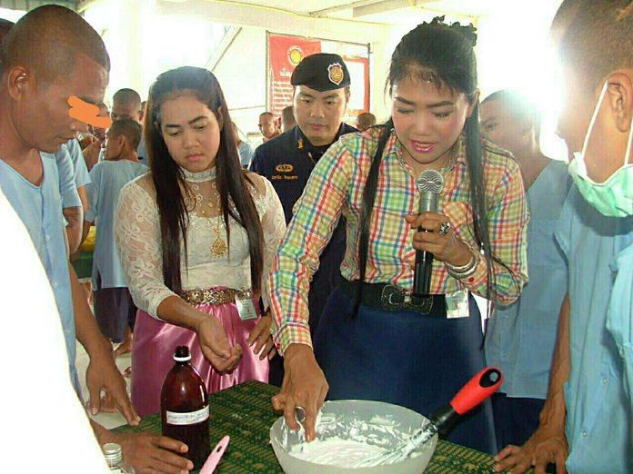 Natcha Khaokrajang demonstrates to the inmates the art of making creams and lotions using herbs and plants.