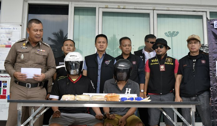 The alleged drug dealers with the illegal substances are displayed at a news conference.