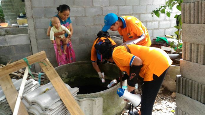 Health workers inspect high risk areas for any signs of breeding mosquitos.