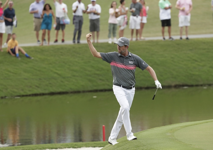 Webb Simpson celebrates an eagle shot on the 11th hole during the third round of The Players Championship golf tournament Saturday, May 12, in Ponte Vedra Beach, Fla. (AP Photo/John Raoux)