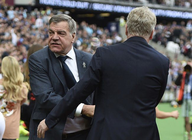 Everton manager Sam Allardyce, left, shakes hands with West Ham manager David Moyes, ahead of the English Premier League soccer match between West Ham United and Everton, at the London Stadium, in London, Sunday May 13. (Daniel Hambury/PA via AP)