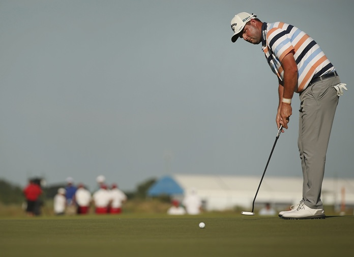 Marc Leishman, of Australia, putts on the 18th hole during the first round of the AT&T Byron Nelson golf tournament Thursday, May 17, in Dallas. (Andy Jacobsohn/The Dallas Morning News via AP)