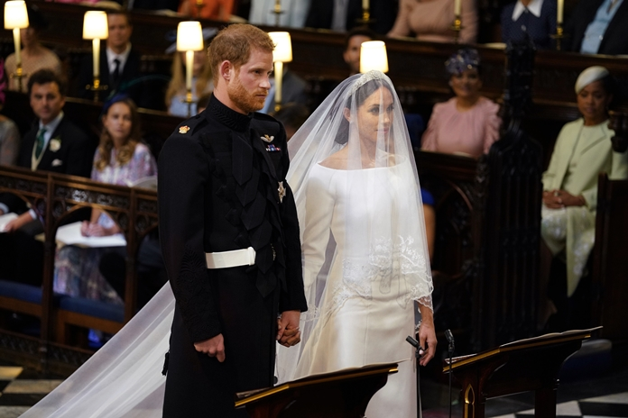 Britain's Prince Harry and Meghan Markle stand, prior to the start of their wedding ceremony, at St. George's Chapel in Windsor Castle in Windsor, near London, Saturday, May 19. (Dominic Lipinski/pool photo via AP)