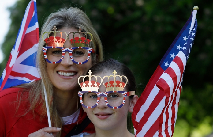 Royal fans pose for a photo prior to the wedding ceremony of Prince Harry and Meghan Markle at Windsor Castle, Saturday, May 19. (AP Photo/Kirsty Wigglesworth)
