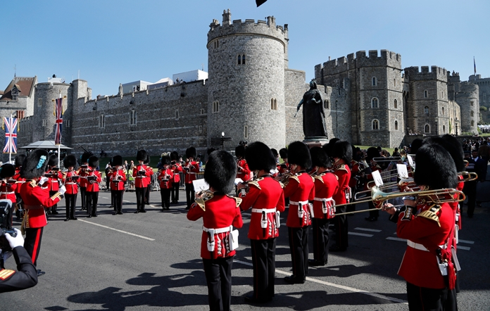 A military brass band plays outside the castle prior to the wedding ceremony of Prince Harry and Meghan Markle. (AP Photo/Frank Augstein)