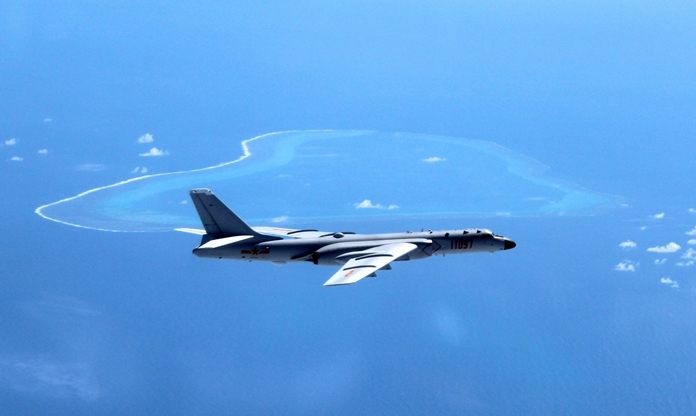 In this undated file photo released by Xinhua News Agency, a Chinese H-6K bomber patrols the islands and reefs in the South China Sea. (Liu Rui/Xinhua via AP)