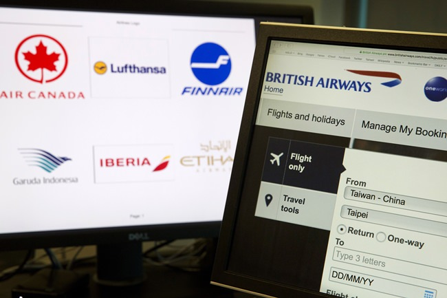 "In this May 21, 2018, photo, a computer screen displays the booking website of British Airways showing ""Taiwan-China"" in Beijing, China. (AP Photo/Ng Han Guan)"