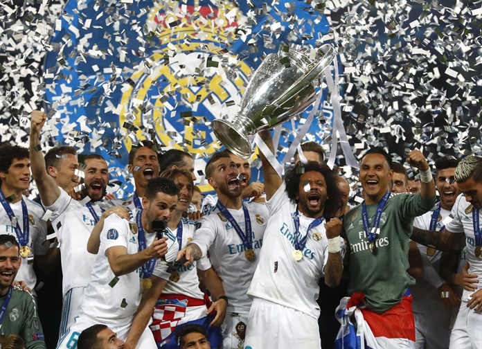 Real Madrid players celebrate with the trophy after winning the Champions League Final against Liverpool at the Olimpiyskiy Stadium in Kiev, Ukraine, Saturday, May 26. (AP Photo/Matthias Schrader)