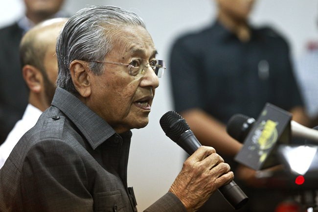 Malaysian Prime Minister Mahathir Mohamad speaks during a press conference in Petaling Jaya, Malaysia, Monday, May 28. (AP Photo/Sadiq Asyraf)
