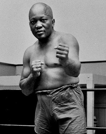 In this 1932 file photo, boxer Jack Johnson, the first black world heavyweight champion, poses in New York City. (AP Photo)