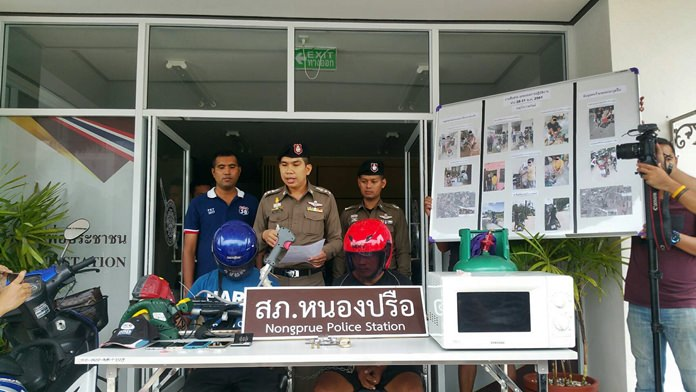 Pol. Col. Chidecha Songhong, Superintendent of Nongprue Police, announces four male suspects were arrested last week during a police crime sweep through the area.